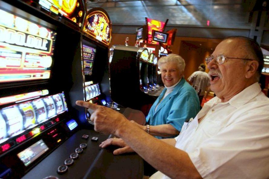 An elderly man won on a slot machine